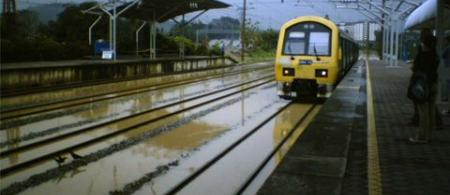 4eb7efefa947ccommuter-train-flooded-tracks - climate adaptation.
