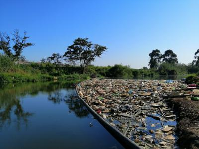 A free flowing water system vs a water system clogged by solid waste