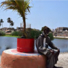 Mamadou Ndiaye, délégué de quartier of Bene Baraque sitting on a design bench. Benches made from recycled materials are arranged around the basins to improve the living environment of the neighbouring districts. Credit: Consortium pour la Recherche Economique et Sociale (CRES).